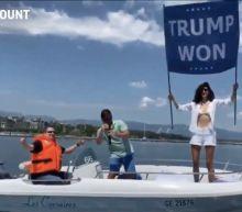 Video shows Osama bin Laden's niece waving a flag saying 'Trump won' on a lake outside the Biden-Putin summit