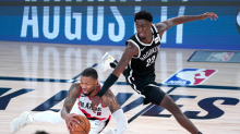 Damian Lillard and Ja Morant lead teams into play-in tournament after wild NBA night