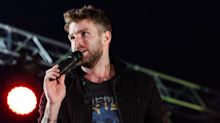 Joel Dommett pays tribute to Caroline Flack at mental health charity gig