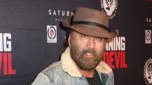 Nicolas Cage's bushy beard and cowboy hat are out in full force at movie premiere