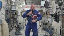 U.S.-Russian crew reaches space station for year-long stay