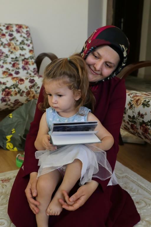 Sumeyye Yilmaz says authorities have provided little help to find her husband Mustafa (AFP Photo/Adem ALTAN)