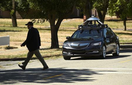 FILE PHOTO: An autonomous version of Acura's RLX Sport Hybrid SH-AWD stops for a simulated pedestrian crossing at carmaker Honda's testing grounds at the GoMentum Station autonomous vehicle test facility in Concord, California, U.S., June 1, 2016. REUTERS/Noah Berger/File Photo
