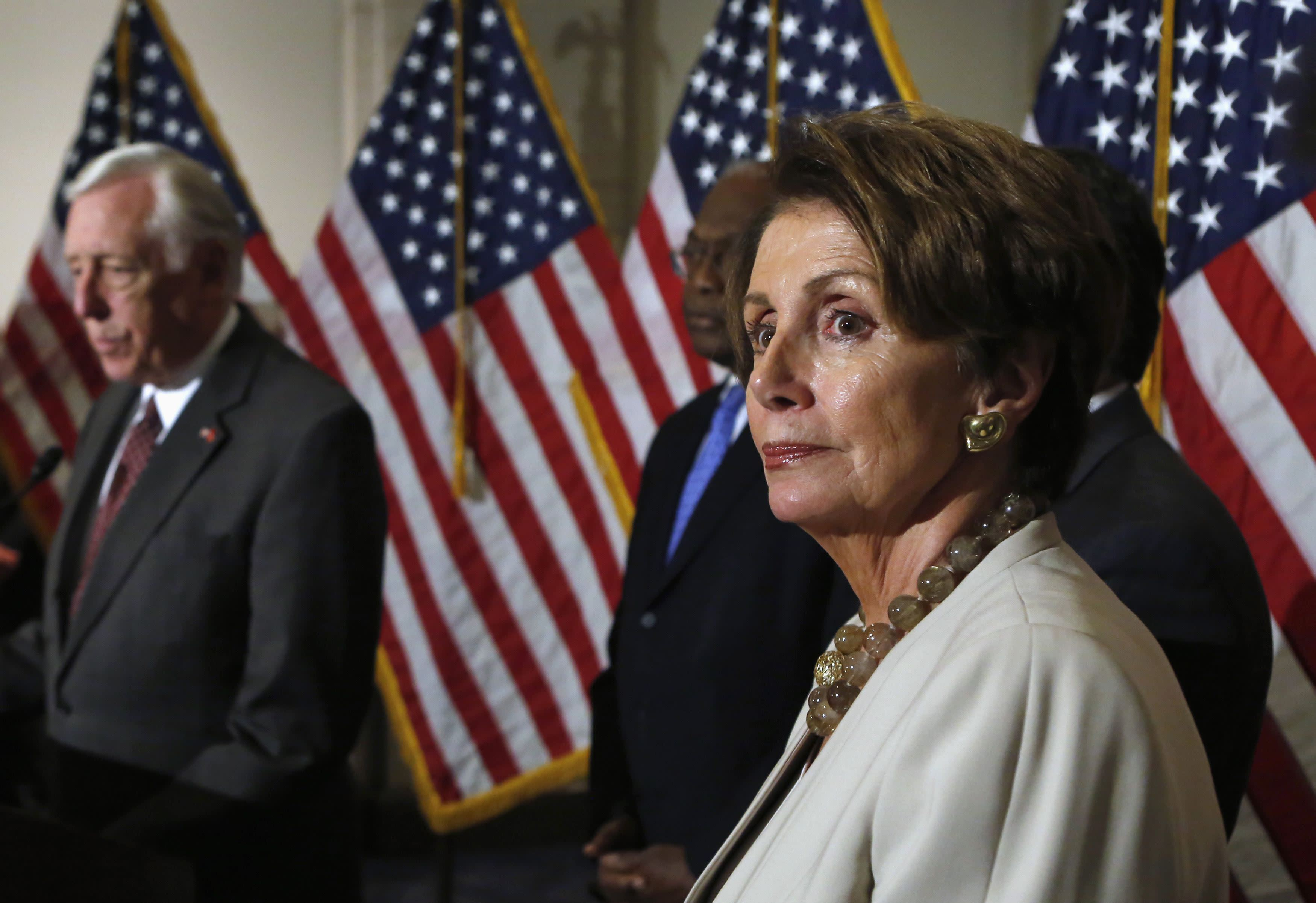 U.S. House Minority Leader Pelosi and Representative Hoyer talk to the media on Obamacare following a Caucus meeting on Capitol Hill in Washington