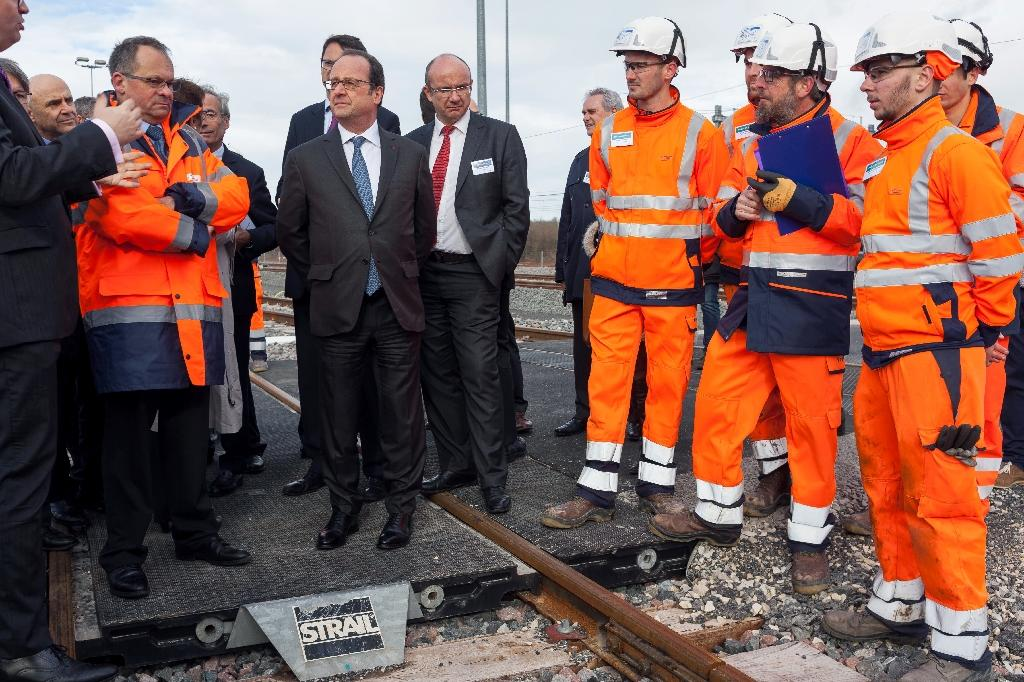 French President Francois Hollande attends the inauguration of the new Sud Europe Atlantique high-speed rail line, linking Tours and Bordeaux, on February 28, 2017, in Villognon, where two were injured when a police officer accidentally fired his gun