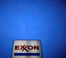 Exxon tries to put the worst behind it with $20 billion writedown