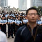 Hong Kong police deployed female cops to clean up their colleagues' mess