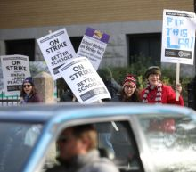 Striking Chicago teachers march through morning rush hour traffic