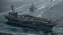 A US aircraft carrier could be stuck in port for almost a month for coronavirus testing, but the Navy is trying to cut that time down