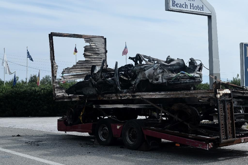 What remains of the car thought to have been carrying migrants when it crashed into a truck and burst into flames killing 11 people