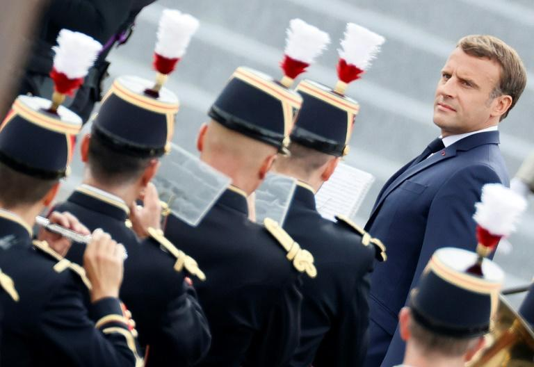 French President Emmanuel Macron reviews the guard of honour during the annual Bastille Day military ceremony in Paris