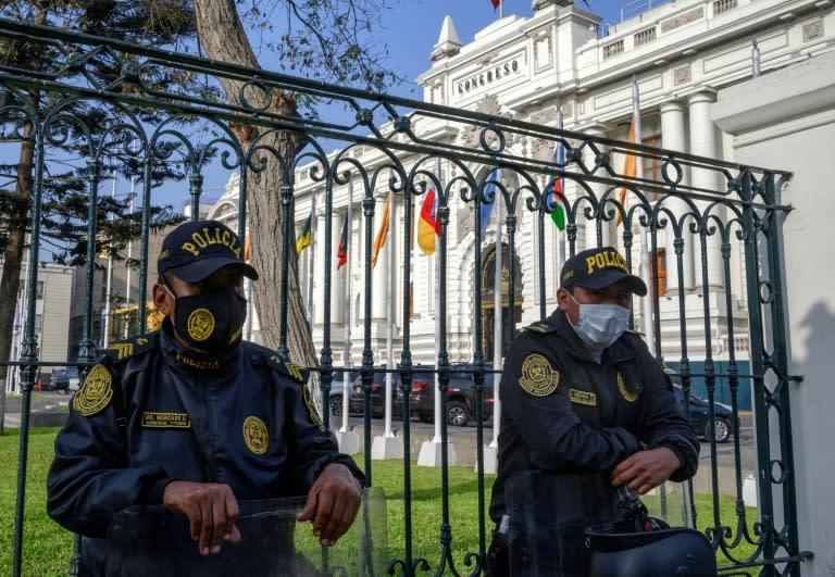 Police stand guard outside Peru's Congress ahead of President Martin Vizcarra's impeachment procedure