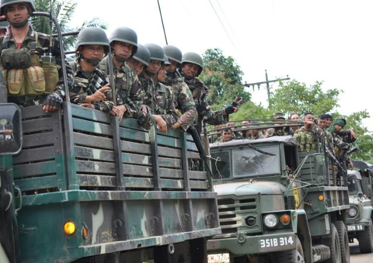Philippine soldiers patrol a road in Sulu province, where the shooting occured