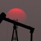 Oil dragged into U.S.-China trade war, prices slump