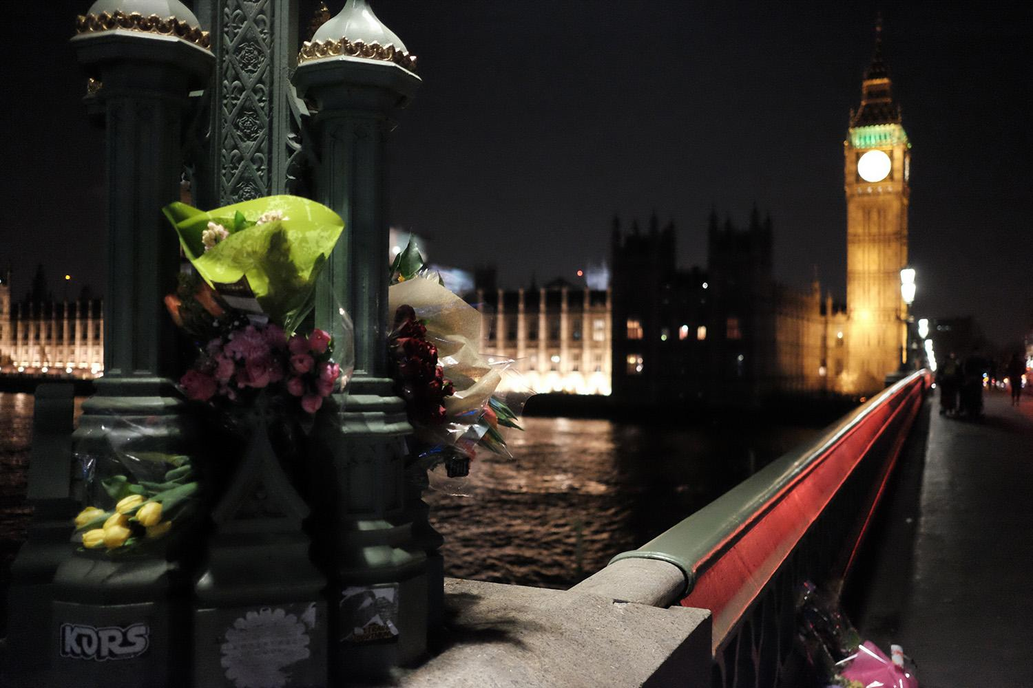<p>Flowers are shown on Westminster Bridge, one of the scenes of the March 22 terror attack, close to the Houses of Parliament in central London, March 23, 2017. (Jay Shaw Baker/NurPhoto via Getty Images) </p>