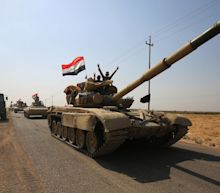Iraqi and Kurdish forces battle over Kirkuk as 'major operation' launched