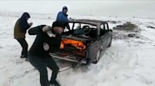 Crazy Russian jumps burning car into icy lake because vodka