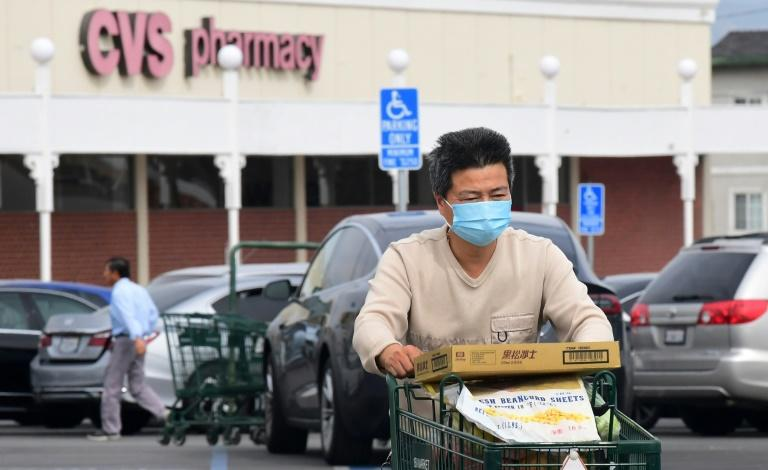 The impact of the COVID-19 epidemic on the US economy so far has been limited (AFP Photo/Frederic J. BROWN)