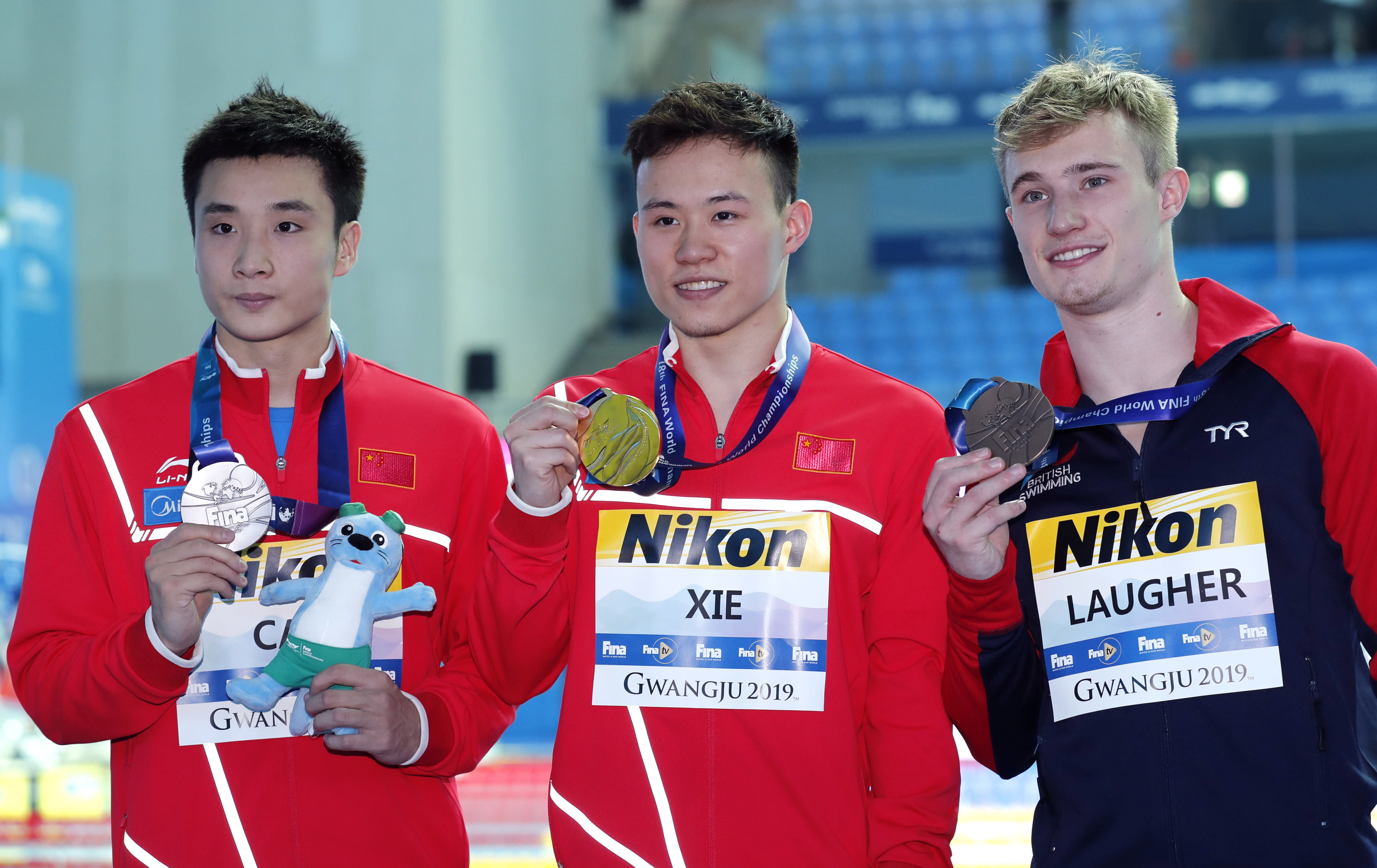After being second until the last round of the semifinals, xie siyi (chn) then performed an outstanding forward 4 ½ somersaults (tuck), scoring 100.70 and finishing first, ahead of his teammate wang zongyuan. Xie wins 3-meter springboard gold after Laugher falters