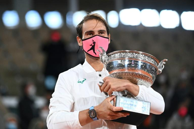 A familiar sight: Rafael Nadal gets his hands on the Coupe des Mousquetaires for a 13th time