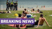 Police descend on beach crowds as Victoria records new Covid cases