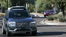 Uber suspends self-driving car tests after vehicle hits and kills a pedestrian