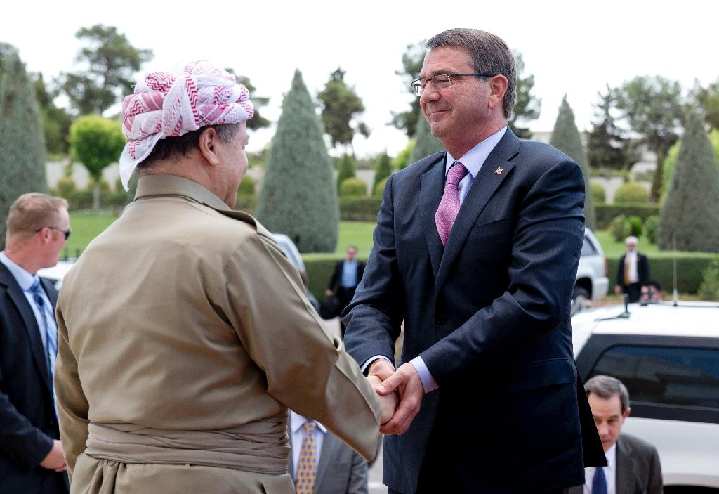 US Defence Secretary Ashton Carter (R) is greeted by Iraqi Kurdish president Massud Barzani in Arbil on July 24, 2015 (AFP Photo/Carolyn Kaster)