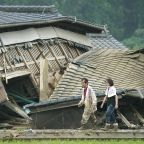 At least 20 dead as floods sweep away houses in south Japan