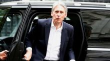 Hammond beats target as deficit hits 16-year low