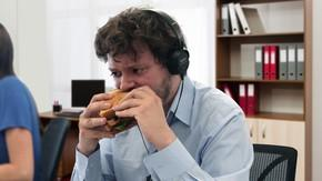 Serious Coworker Puts Headphones On To Focus On Sandwich