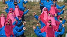 Indonesian politician's anti-virus veil policy draws fire