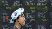 Asian shares mostly lower, weighed by trade tensions