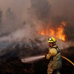 Villagers, firefighters battle huge blazes in central Portugal