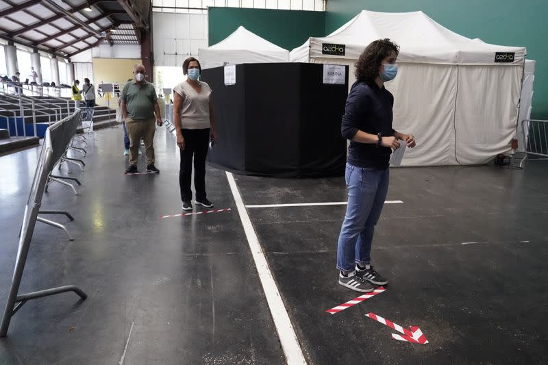 People maintain social distancing before voting during the Basque regional elections, amid the coronavirus disease (COVID-19) outbreak, in Ordizia