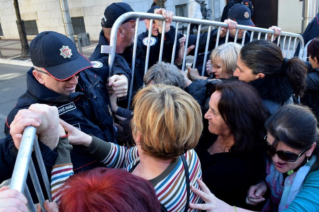 Women scuffle with police during a protest on February 16, 2017 in Podgorica over social benefits cuts affecting mothers with three or more children, introduced as the country is facing growing public finances problems (AFP Photo/SAVO PRELEVIC)