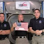 NASA's Dragon riders capture the flag, nine years after it was left on the space station