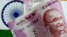 Most Asian FX restrained by cautious sentiment, rupee rallies