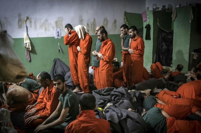 The prisoners live cheek by jowl in crowded cells with barely enough room to move (AFP Photo/FADEL SENNA)