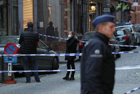 Police keep watch outside the police headquarters after a policeman was stabbed in Brussels, Belgium November 20, 2018. REUTERS/Yves Herman