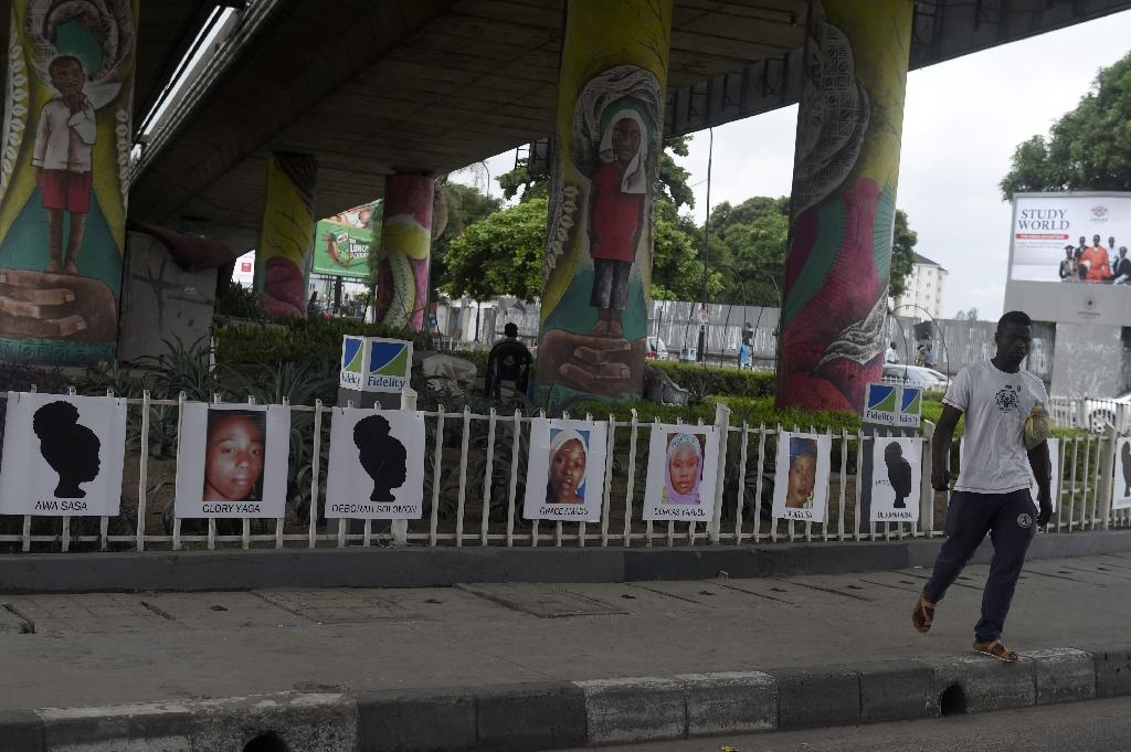 At a big traffic junction in the centre of the economic capital Lagos, drivers no longer pay attention to the girls' pictures hung along the railings (AFP Photo/PIUS UTOMI EKPEI)