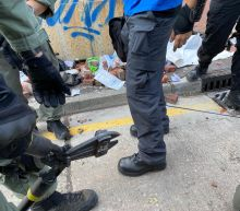 The Latest: Protesters block main road in Hong Kong