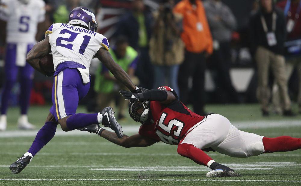 Minnesota Vikings running back Jerick McKinnon (21) runs past Atlanta Falcons middle linebacker Deion Jones (45) during Minnesota's win Sunday. (AP)