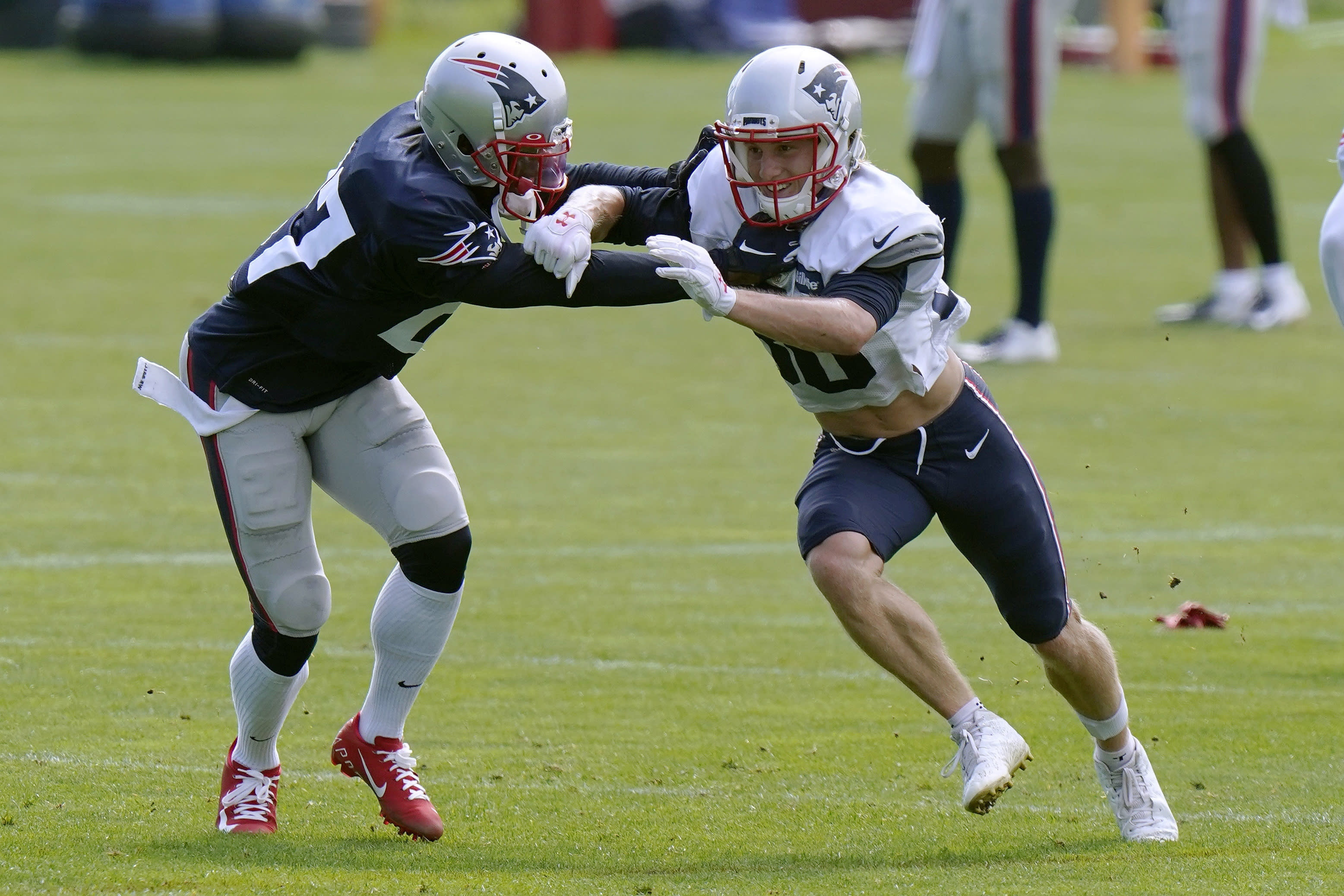 New England Patriots defensive back J.C. Jackson (27) and wide receiver Gunner Olszewski (80) run a passing drill during an NFL football training camp practice, Monday, Aug. 24, 2020, in Foxborough, Mass. (AP Photo/Steven Senne, Pool)