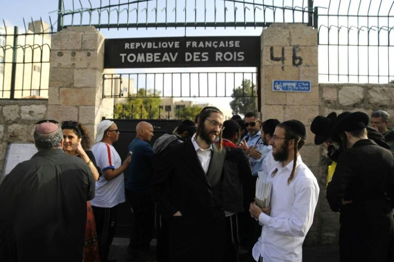 Ultra-Orthodox Jews danced and prayed while they waited to visit the 2,000-year-old tomb (AFP Photo/MENAHEM KAHANA)