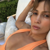 Jennifer Lopez poses in revealing peach swimsuit at 49 and fans are speechless: 'How do you look like this?'