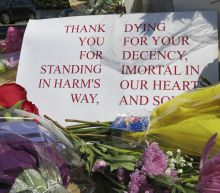 The Latest: Mother to victims: 'You will always be our hero'