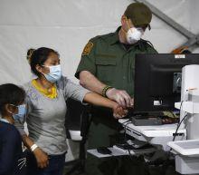 US drops Trump plan for more biometric data on immigrants