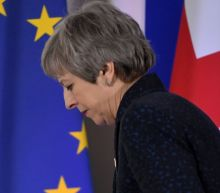 May pushes for Brexit deal with new timetable
