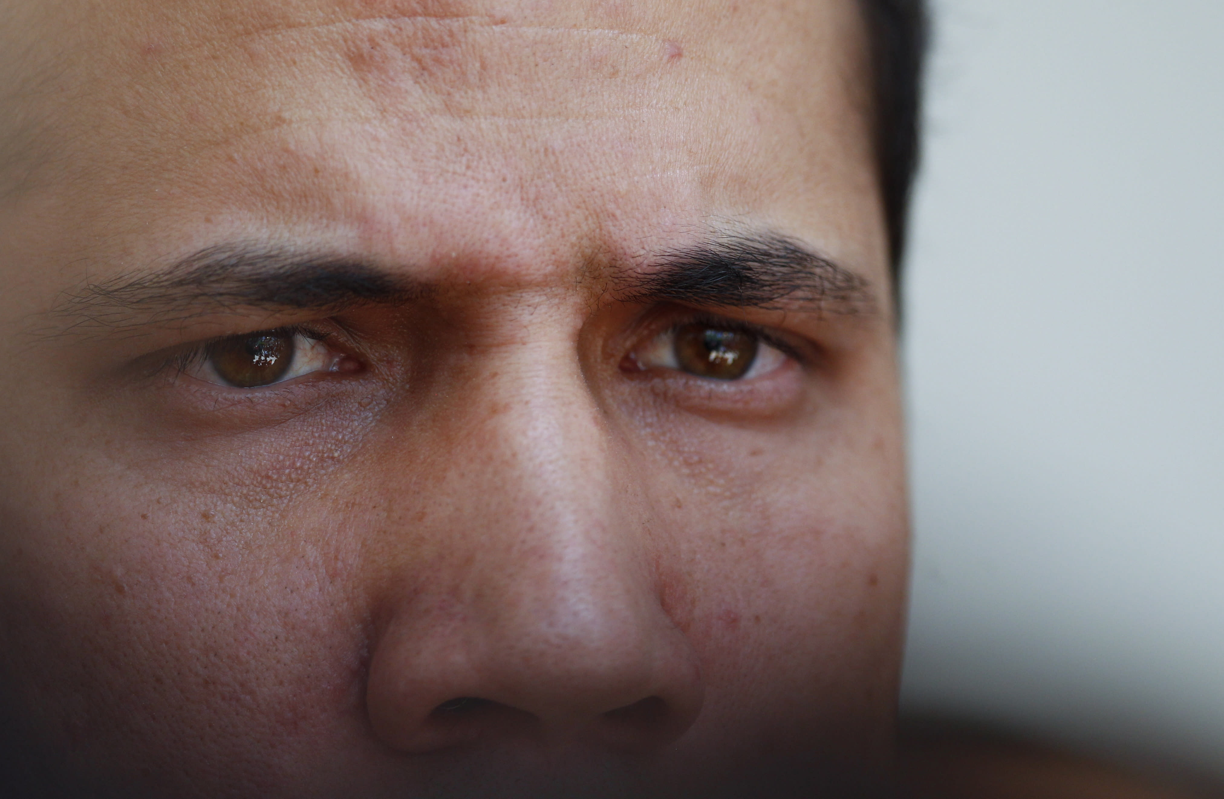 Opposition leader and self-proclaimed interim president of Venezuela, Juan Guaido, speaks to the press at the National Assembly in Caracas, Venezuela, Tuesday, Aug. 20, 2019. The opposition-controlled National Assembly meets every Tuesday, and today lawmakers met to discuss the government's bid to relieve hyperinflation. (AP Photo/Leonardo Fernandez)