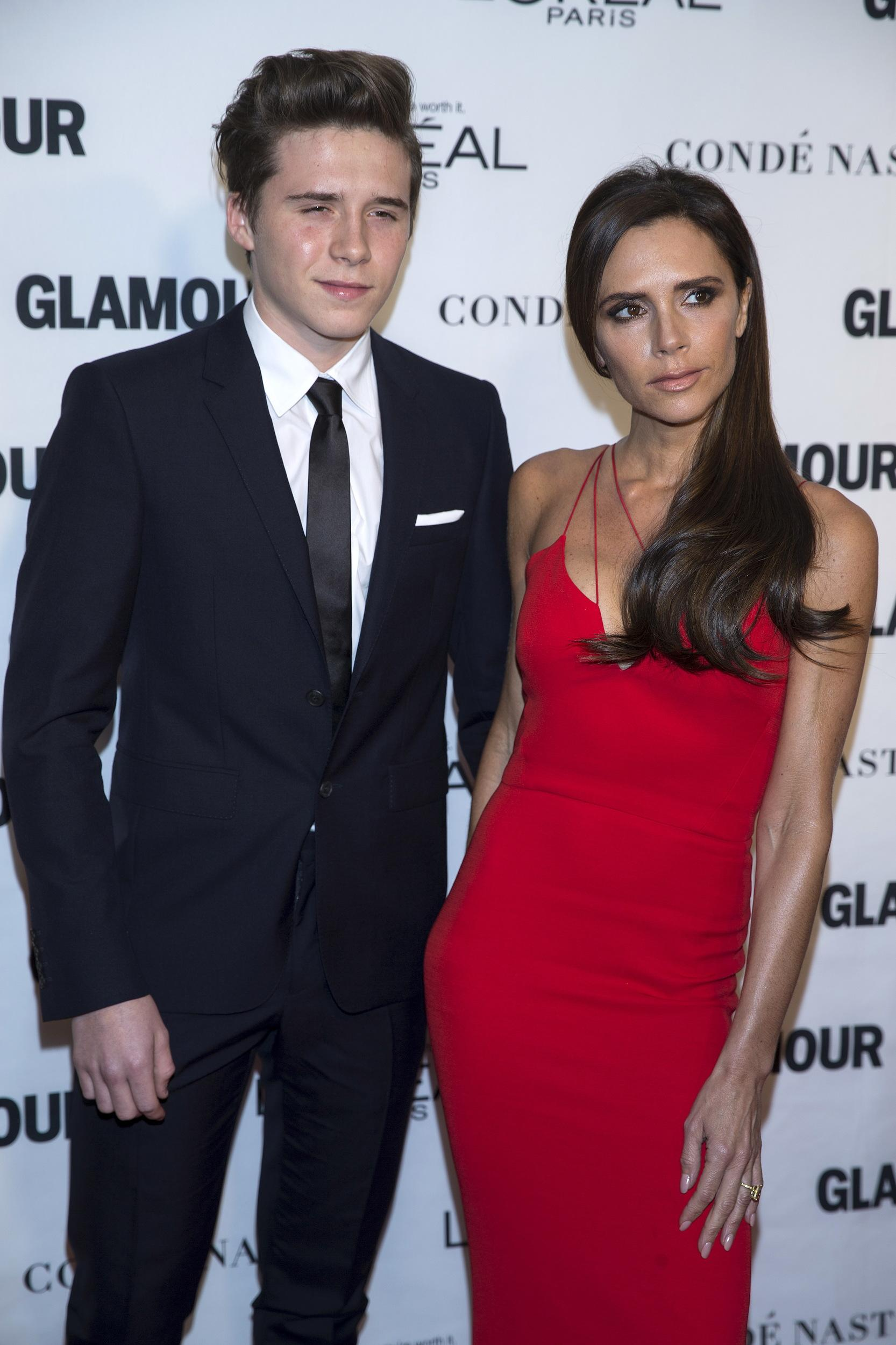 """Designer Victoria Beckham and son Brooklyn Beckham arrive for the """"Glamour Women of the Year Awards"""" in the Manhattan borough of New York, November 9, 2015. REUTERS/Carlo Allegri"""